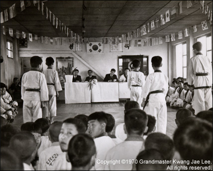 Photo: Master Lee and his students during a Black Belt Test ceremony.