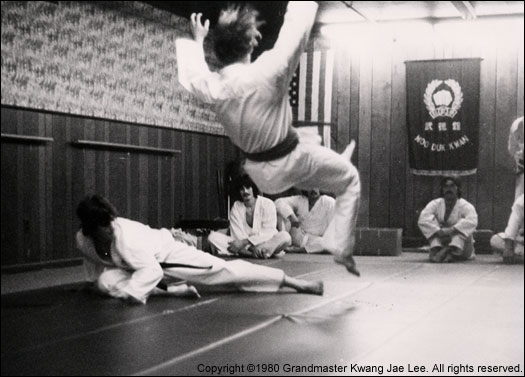 Photo: Students Michael Moschitta and Walter Kopitov demonstrate a leg sweep maneuver.