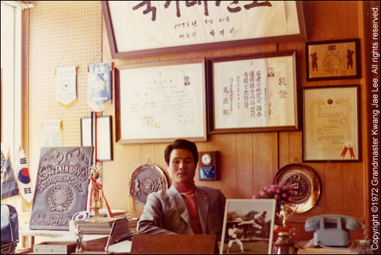 Photo: Master Lee seated in his office.