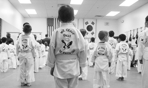 Students stand at attention during Tae Kwon Do class